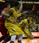 Missouri forward, Tony Criswell (3), tries to get the ball to the post,  to  teammate Alex Oriakhi (42).