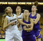 Sophomore Morgan Eye (30) and Senior Liz Smith (45) prepare themselves for a rebound with two Western Illinois players.