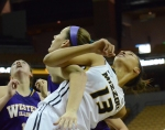 Forward Bri Kulas (13) fights with a Western Illinois player for a rebound.