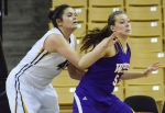 Senior center Liz Smith (45) fends off Leatherneck player Ashley Luke (5).