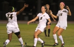 Danielle Nottingham (8) celebrates her game-tying goal with teammates Alyssa Diggs (14) and Allison Hu (15).