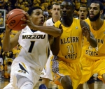 Missouri guard Phil Pressey (1) drives past Alcorn State's Martrevious Sanders (11). Pressey led all scorers with 21 points while also recording 3 steals in Missouri's 91-54 win.