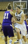 Senior Liene Priede (32) moves past Western Illinois guard Saule Kontautaite (21) to get in position. Priede contributed five defensive rebounds for the Tigers.