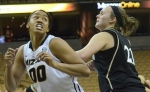 Missouri forward Darian Saunders (00) battles for positioning with Lindenwood's Tori Kuhn (21) during a game on Tuesday, Nov. 6. The Tigers won 88-46.