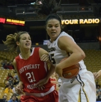 Senior center Liz Smith (45) defends against Southeast Missouri's Connor King  (21) at Mizzou Arena on Thursday night. Smith grabbed seven rebounds and three assists for Missouri.