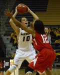 Freshman guard Maddie Stock (10) looks for a pass as Southeast Missouri's Kara Wright (12) defends her. Stock scored three 3-pointers for Missouri.