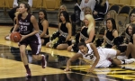 Missouri's Sydney Crafton slides on the floor after trying to steal the ball from SIU's Jordyn Courier (23). Crafton contributed 12 points to the 110-47 win.