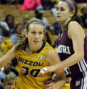 Sophomore guard Morgan Eye (30) maneuvers around Missouri State's Kenzie Williams (4). Eye continued her 3-point streak on Thursday, sinking five 3-pointers and leading Missouri with 21 points.