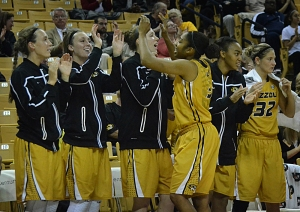 Sophomore guard Bree Fowler (3) high fives her teammates during a break in the action on Thursday night. The Tigers improved to 7-2.
