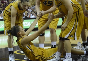 Kyley Simmons, left, and other teammates help junior forward Bri Kulas off the floor after being fouled by Missouri State's Whitney Edie. Kulas contributed 17 points for Missouri.