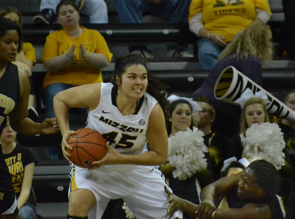 Senior center Liz Smith (45) holds onto a rebound as she tries to defend against Arkansas-Pine Bluff player Alexi Rollins (33). Smith grabbed nine rebounds for Missouri.