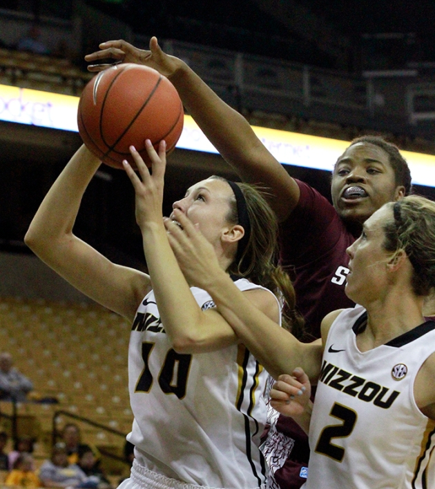 Maddie Stock (10) goes for a layup as a Southern Illinois defender tries to block the shot. Looking on is Morgan Stock (2), Maddie Stock's twin sister.