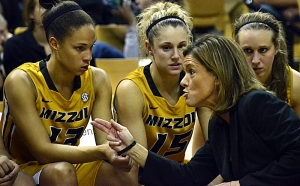 Missouri coach Robin Pingeton talks to Bri Kulas (13) Kyley Simmons (15) and Morgan Eye on the bench during Thursday's game.