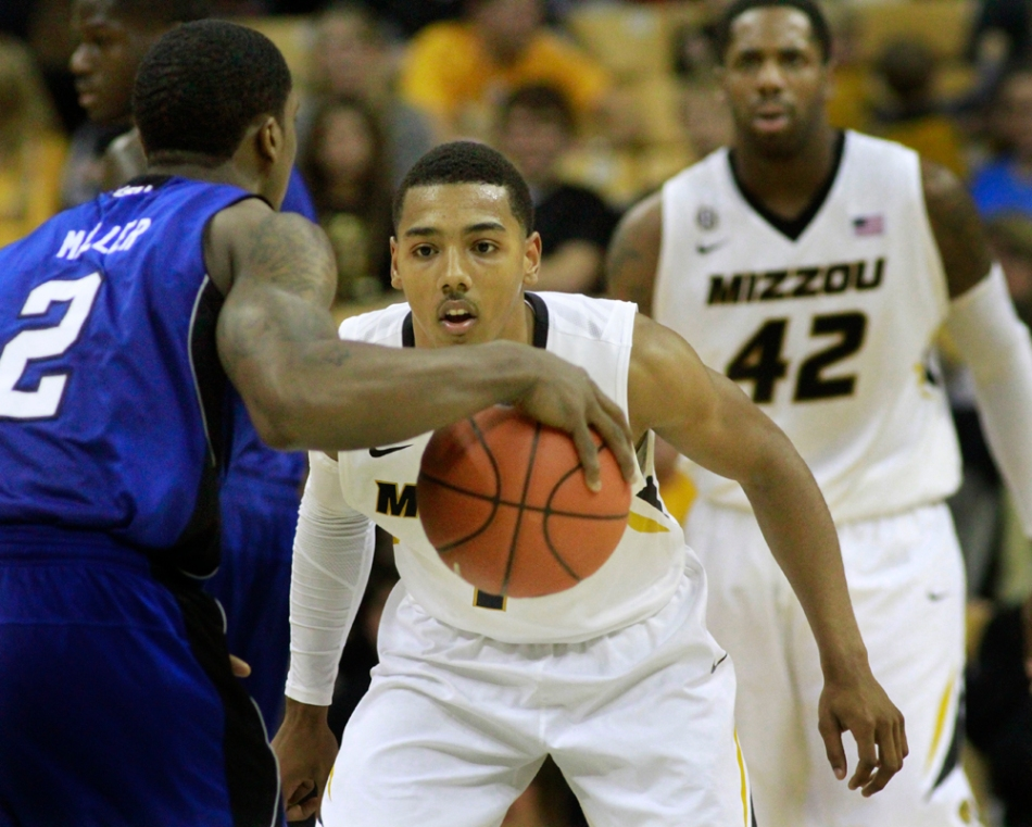 Phil Pressey (1) keeps an eye on Patrick Miller (2) as he dribbles up the floor, with Alex Oriakhi (42) defending the post.