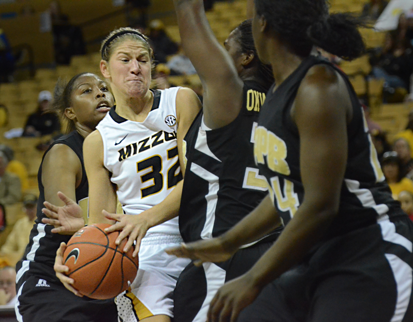 Three Arkansas-Pine Bluff players pressure senior guard Liene Priede as she attempts to shoot. Priede had five assists for the Tigers.