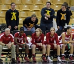 Members of The Antlers student club yell from behind the Arkansas bench in Thursday's game. They were moved from that section shortly after the game started.