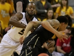 Keion Bell strips the ball from a Vanderbilt player, getting one of his three steals of the game.