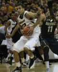Jabari Brown (32) drives to the basket past Vanderbilt's Kyle Fuller (11). Brown finished with 21 points in the win over Vanderbilt.