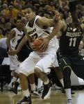 Jabari Brown (32) drives to the basket past Vanderbilt's Kyle Fuller (11). Brown finished with 21 points in the win over Vanderbilt.