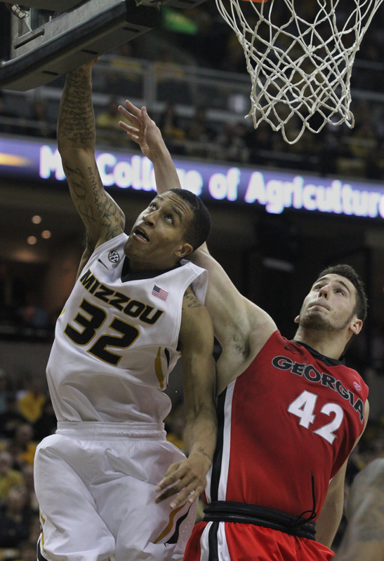 Missouri's Jabari Brown works underneath the basket against Nemanja Djurisic.