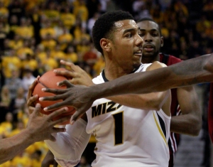 Two defenders try to steal the ball from point guard Phil Pressey (1).