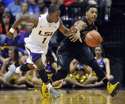 LSU guard Anthony Hickey (1) and Missouri guard Phil Pressey (1) chase after a loose ball during the first half of an NCAA college basketball game  at the Pete Maravich Assembly Center in Baton Rouge, La., Wednesday, Jan. 30, 2013. (AP Photo/Bill Feig)