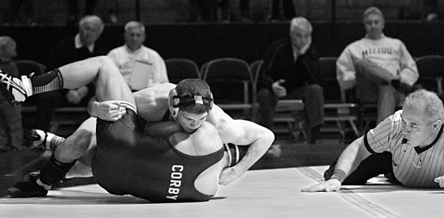 Official Jerry Middleton watches as Missouri's Drake Houdashelt get the near fall on Donnie Corby of Central Michigan. Houdashelt won the 149 bout, 8-2.