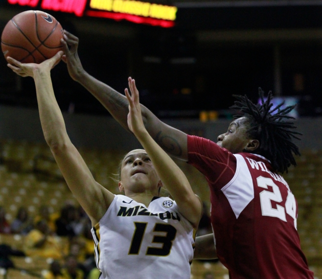 Bri Kulas (13) has her shot rejected by Arkansas' Quistelle Williams (24) Thursday ight. Missouri lost to Arkansas, 58-50 Thursday, Jan. 24, 2013 at Mizzou Arena in Columbia, Mo. Photo by Karen Mitchell