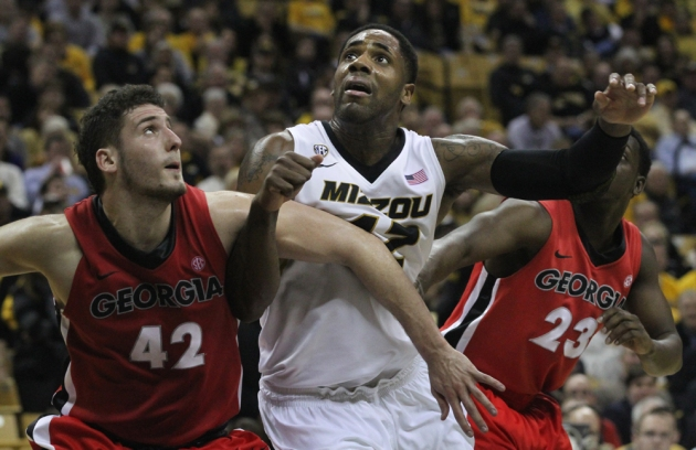 Alex Oriakhi, center, was called on to step up his game in the absence of injured starter Laurance Bowers. Oriakhi works in the paint against Georgia defenders Nemanja Djurisic (42) and Sherrard Brantley (23) on Wednesday, Jan. 16, 2013 at Mizzou Arena.
