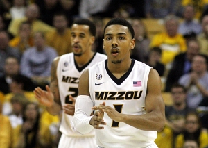 Phil Pressey (1) and Laurence Bowers (21) start to celebrate as Missouri pulls away from Alabama in the second half.