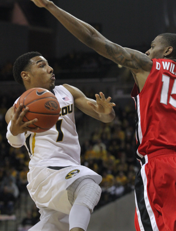 Phil Pressey (1) drives toward the basket against Georgia's Donte' Williams (15).