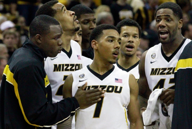 Phil Pressey (1) is congratulated by teammates near the end of Saturday's game. Pressey scored a career-high 26 points.