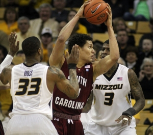 South Carolina's Michael Carrera (24) is double-teamed by Earnest Ross (33) and Tony Criswell (3).