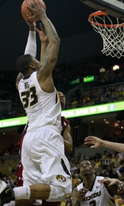 Earnest Ross (33) drives to the basket in the first half. He finished with 21 points and 10 rebounds.