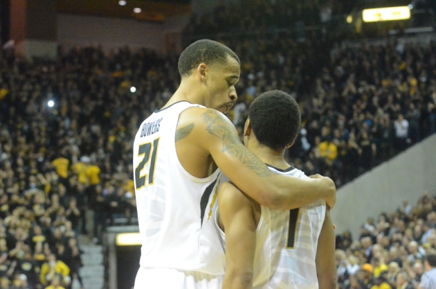 Missouri's Laurence Bowers (21) and Phil Pressey (1) embrace as Missouri's Keion Bell hits two free throws with 3 seconds left to seal the win for Mizzou.