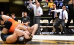 Wrestling coaches Brian Smith and Sammie Henson yell for nearfall when the Tigers land in an awkward position. It is Henson's first year with the Missouri program.
