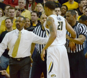 Missouri coach Frank Haith pulls Laurence Bowers away from a scuffle in the second half of Saturday's win over Ole Miss.