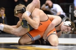Senior Brent Haynes ties up his opponent's lower body in an attempt to scramble for more control. Haynes is a three-time qualifier for the NCAA tournament out of Oak Park High School in Kansas City.