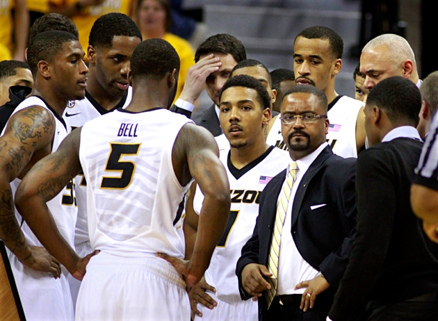 Frank Haith, right, huddles with the team during a time out in the Auburn game. Missouri is 14-0 at home and winless on the road.