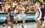 Point guard Kyley Simmons (15) and guard Sydney Crafton (21) double team Katia May of Mississippi State as the Tigers put full court pressure on the Bulldogs in the dying minutes of the second half.