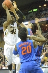 Missouri's Alex Oriakhi (42) goes up for a jump shot in the face of Florida's, Michael Frazier (20), Erik Murphy (33) and Casey Prather (24).