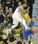 Phil Pressey jumps high to defend against Florida's Scottie Wilbekin (5).