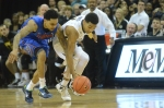 Missouri's Phil Pressey (1) scrambles to steal the ball as Florida's Mike Rosario (3) fights to regain control after the Gators make a turnover in the second.