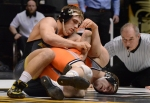 Todd Porter works on Chris Perry's elbow during his victory over the No. 1 Oklahoma State Cowboy. Porter accumulated 2:25 of riding time entering the third period—locking up an addition point at the end of the match to give Porter the major decision.