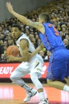 Guard Phil Pressey (1) looks for an assist against Florida's Scottie Wilbekin (5). Pressey finished with 10 assits and six points.