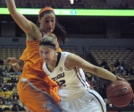 Liene Priede dribbles to the basket. Priede finsihed with six points and three rebounds for the Tigers.