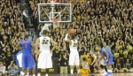 Missouri's Earnest Ross (33) shoots a free throw late in the second half as Jabari Brown (32) and Florida's Kenny Boynton (1) look on. Ross was good on both free throws, finishing the night with 11 points and four rebounds.