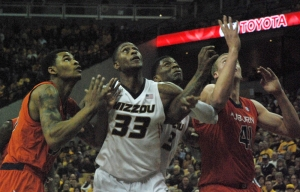 Missouri's Earnest Ross battles for rebounding position against his former team. Missouri beat Auburn 91-77 on Saturday.