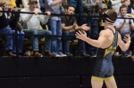 Missouri captain Nathan McCormick celebrates to the home fans at the Hearnes Center. McCormick upset fourth-ranked Jon Morrison 4-2 to move to 24-3 on the season.