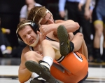 Alan Waters controls his opponent from behind. Oklahoma State's Eddie Klimara struggles to scoot away from Waters and get an escape. Waters won 4-3 in a tight match.